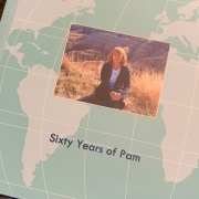 Image of woman super imposed on image of map on a photo album that's a 60th Birthday Album.